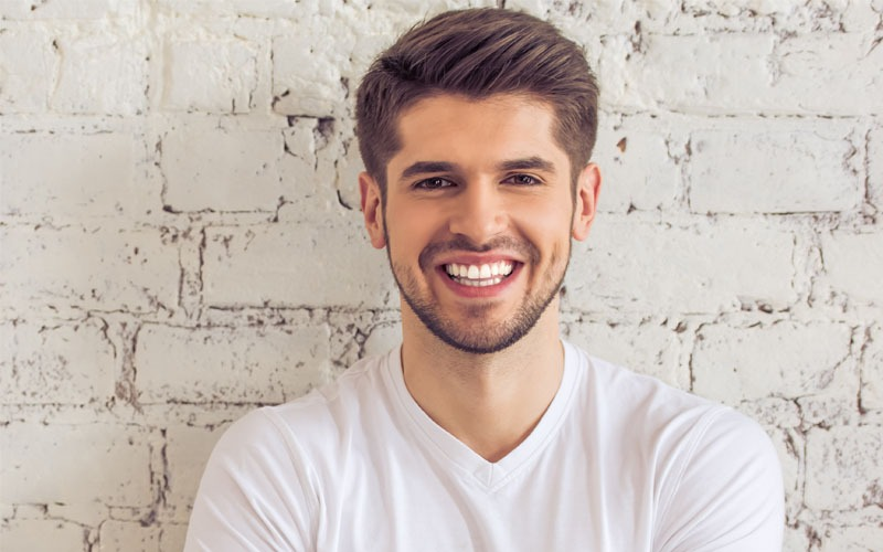 Smiling man with straight teeth